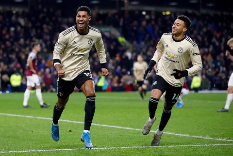 Manchester United's Marcus Rashford, left, celebrates scoring his second goal of the game with team mate Jesse Lingard during the English Premier League soccer match at Turf Moor, Burnley, England, Saturday, Dec. 28, 2019. (Martin Rickett/PA via AP)
