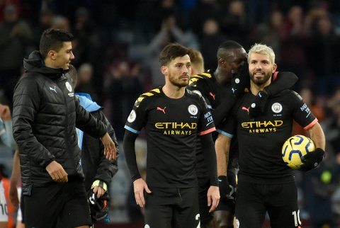 Manchester City's Sergio Aguero, right with teammates leave the field after the English Premier League soccer match between Aston Villa and Manchester City at Villa Park in Birmingham, England, Sunday, Jan. 12, 2020. Manchester City won the game 1-6. (AP Photo/Rui Vieira)