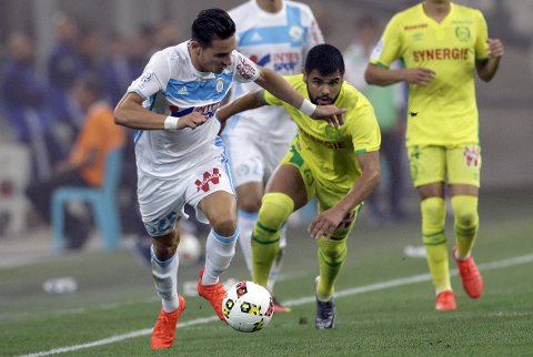 Marseille's forward Florian Thauvin, left, challenges for the ball with Nantes' forward Lucas Lima, during the League One soccer match between Marseille and Nantes, in Marseille, southern France, Sunday, Sept. 25, 2016. (AP Photo/Claude Paris)