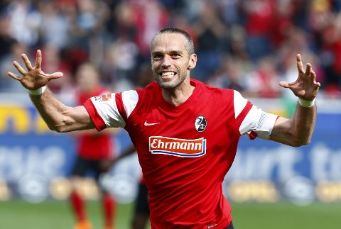 Freiburg's Pavel Krmas celebrates the victory of his team against Bayern Munich after their German Bundesliga first division soccer match in Freiburg, Germany, May 16, 2015. Freiburg won the match 2-1.  REUTERS/Ralph Orlowski   DFL RULES TO LIMIT THE ONLINE USAGE DURING MATCH TIME TO 15 PICTURES PER GAME. IMAGE SEQUENCES TO SIMULATE VIDEO IS NOT ALLOWED AT ANY TIME. FOR FURTHER QUERIES PLEASE CONTACT DFL DIRECTLY AT + 49 69 650050