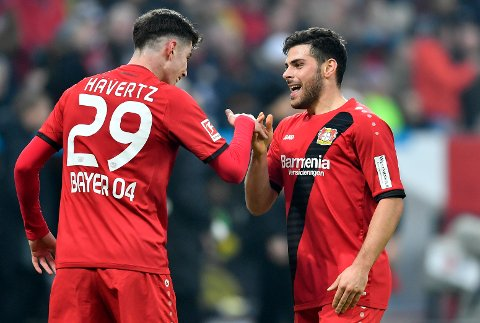 Leverkusen's scoreer Kevin Volland celebrates with Leverkusen's Kai Havertz, from right, during the German Bundesliga soccer match between Bayer Leverkusen and Borussia Dortmund in Leverkusen, Germany, Saturday, Dec. 2, 2017. (AP Photo/Martin Meissner)