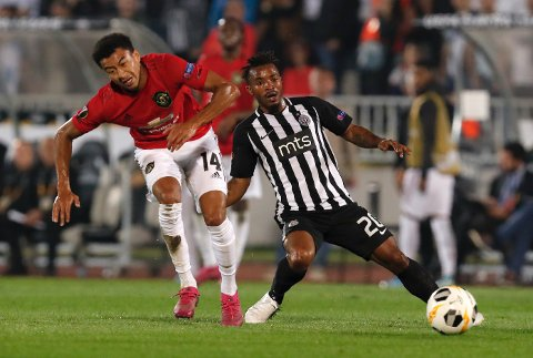 Manchester United's Jesse Lindgard, left, challenges for the ball with Partizan's Seydouba Soumah during the Europa League group L soccer match between Partizan Belgrade and Manchester United at the Partizan stadium in Belgrade, Serbia, Thursday, Oct. 24, 2019. (AP Photo/Darko Vojinovic)