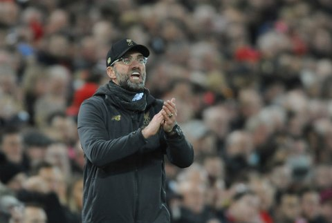 Liverpool's manager Jurgen Klopp gestures to his players during the English Premier League soccer match between Liverpool and Arsenal at Anfield in Liverpool, England, Saturday, Dec. 29, 2018. (AP Photo/Rui Vieira)