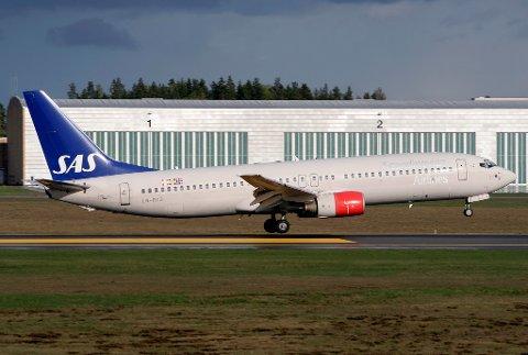 Måtte av: Det var dette flyet, fra Malaga til Oslo mandag, hvor en familie ikke fikk være med. De måtte forlate flyet fordi en av dem var forkjølet.