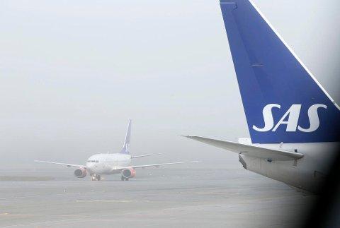 MÅTTE SLUTTE: En SAS-pilot ble tatt i en promillekontroll. Nå er han ute av selskapet. Illustrasjonsfoto. Foto: Terje Pedersen (NTB scanpix)
