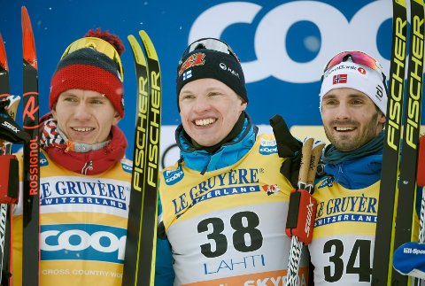 Winners gather, with from left, 2nd placed Aleksandr Bolshunov of Russia, winner Iivo Niskanen of Finland and 3rd placed Hans Christer Holund of Norway, after men's classic style 15 km cross country skiing competition at the FIS World Cup Lahti Ski Games 2020 in Lahti, Finland, on Saturday Feb. 29, 2020. (Markku Ulander/Lehtikuva via AP)