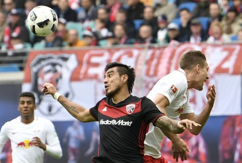 Ingolstadt's Dario Lezcano, left, challenges for the ball with Leipzig's Stefan Ilsanker, right, during the German first division Bundesliga soccer match between RB Leipzig and FC Ingolstadt 04 in Leipzig, Germany, Saturday, April 29, 2017. (AP Photo/Jens Meyer)