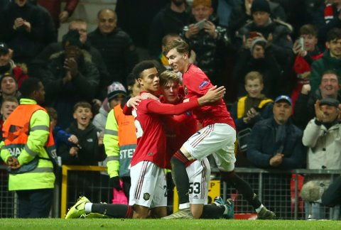 Manchester United's Mason Greenwood, left, celebrates scoring his side's second goal of the game during the Europa League group L soccer match between Manchester United and AZ Alkmaar at Old Trafford in Manchester, England, Thursday, Dec. 12, 2019. (AP Photo/Dave Thompson)