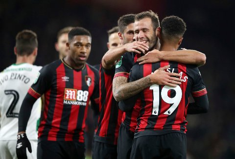 6fe6837a Bournemouth's Junior Stanislas, right, celebrates scoring his side's first  goal of the game during