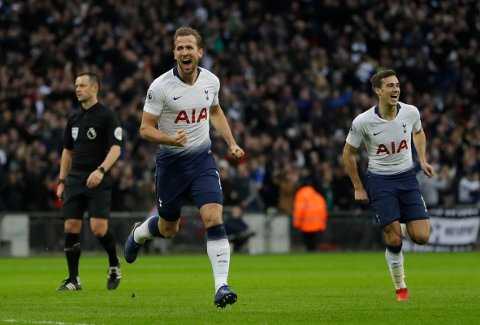 Tottenham Hotspur's Harry Kane, left, celebrates after scoring the opening goal of the game during their English Premier League soccer match between Tottenham Hotspur and Wolverhampton Wanderers at Wembley stadium in London, Saturday, Dec. 29, 2018. (AP Photo/Kirsty Wigglesworth)