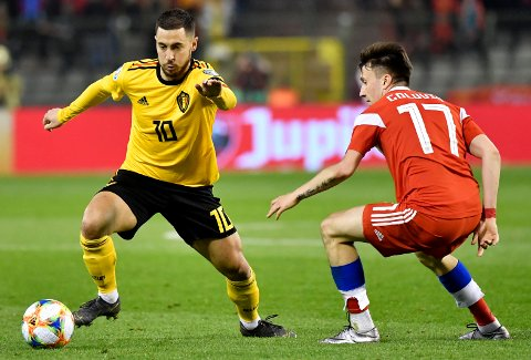 Russia's Aleksandr Golovin, right, challenges Belgium's Eden Hazard, left, during the Euro 2020 Group I qualifying match between Belgium and Russia at the King Baudouin stadium in Brussels on Thursday March 21, 2019. (AP Photo/Geert Vanden Wijngaert)
