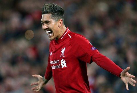 Roberto Firmino scoret to av målene til Liverpool sist rødtrøyene møtte Norwich. Den gangen vant Liverpool 5-4 på Carrow Road.  Her jubler brasilianeren etter å ha scoret mot Porto i Champions League.  (AP Photo/Dave Thompson)
