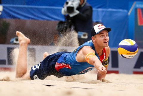 Norway's Christian Sandlie Sorum returns the ball during the round of 16 Beach Volleyball World Cup match against Latvia in the Rothenbaum stadium, Hamburg, Germany, Friday July 5, 2019. (Christian Charisius/dpa via AP)