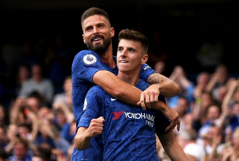 Chelsea's Mason Mount, right, celebrates with teammate Olivier Giroud after scoring his side's first goal during the English Premier League soccer match between Chelsea and Leicester City at Stamford Bridge stadium in London, Sunday, Aug. 18, 2019. (Steven Paston/PA via AP)