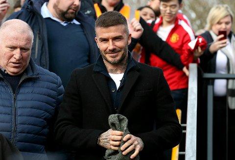 David Beckham og fem andre tidligere United-spillere har gått inn på eier siden i Salford. I februar var Beckham på tribunen da den nye klubben hans tapte 1-3 mot Dover i februar. (Martin Rickett/PA via AP)