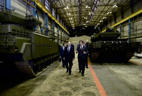 Russian President Vladimir Putin (L) listens to Andrei Terlikov, the head of the Ural Transport Machine Building Design Bureau, as they watch Russian infantry fighting vehicle with the Armata Universal Combat Platform and a T-14 Armata main battle tank at he Uralvagonzavod factory in the Urals city of Nizhny Tagil, Russia November 25, 2015. Speaking on a trip to the Ural mountains city of Nizhny Tagil, Putin ordered the despatch of an advanced weapons system to Russia's Khmeimim air base in Syria's Latakia province. REUTERS/Alexei Nikolskyi/Sputnik/Kremlin ATTENTION EDITORS - THIS IMAGE HAS BEEN SUPPLIED BY A THIRD PARTY. IT IS DISTRIBUTED, EXACTLY AS RECEIVED BY REUTERS, AS A SERVICE TO CLIENTS.      TPX IMAGES OF THE DAY