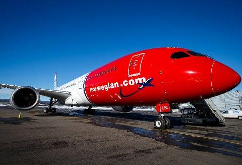 Et av Norwegians fly på Oslo lufthavn. Foto: Heiko Junge / NTB scanpix Foto: (NTB scanpix)