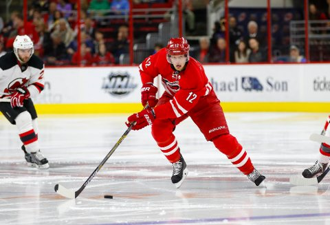 Dec 26, 2015; Raleigh, NC, USA;  Carolina Hurricanes forward Eric Staal (12) skates with the puck against the New Jersey Devils during the second period at PNC Arena. The Carolina Hurricanes defeated the New Jersey Devils 3-1. Mandatory Credit: James Guillory-USA TODAY Sports
