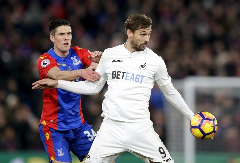 Swansea City's Fernando Llorente, right, vies for the ball with Crystal Palace's Martin Kelly during the English Premier League soccer match between Crystal Palace and Swansea City at Selhurst Park stadium, in London, Tuesday, Jan. 3, 2017. (AP Photo/Alastair Grant)