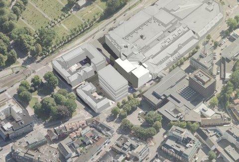 PLANER: Slik ser man for seg den nye «Farmandsporten». Den planlagte utvidelsen er i hvitt, mens et planlagt nytt offentlig bygg er i grått til venstre.