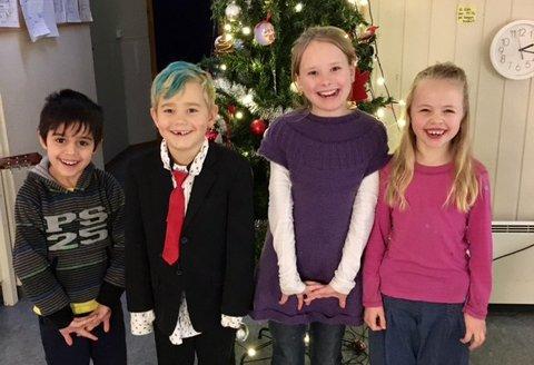 Payman, Jonas, Malin og Marte koste seg på julebord på Mørkvedmarka SFO.
