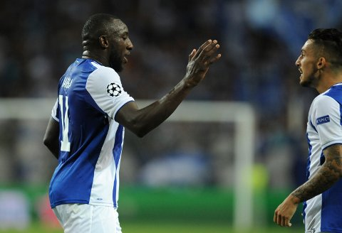 Porto's Moussa Marega, left, celebrates his side's first goal with teammate Alex Telles during the Champions League group G soccer match between FC Porto and Besiktas at the Dragao stadium in Porto, Portugal, Wednesday, Sept. 13, 2017. (AP Photo/Paulo Duarte)