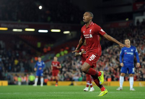 Liverpool's Daniel Sturridge celebrates after scoring his side's opening goal during the English League Cup soccer match between Liverpool and Chelsea at Anfield stadium in Liverpool, England, Wednesday, Sept. 26, 2018. (AP Photo/Rui Vieira)