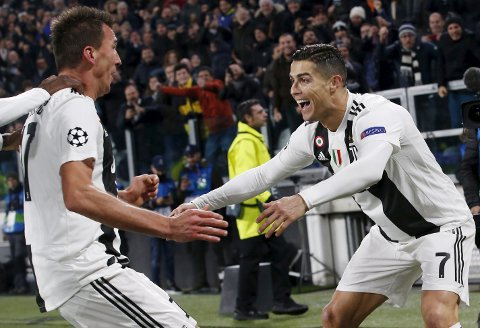 --ALTERNATIVE VERSION OF XLB133--Juventus forward Mario Mandzukic, left, celebrates with his teammate Cristiano Ronaldo after scoring during the Champions League group H soccer match between Juventus and Valencia at the Allianz stadium in Turin, Italy, Tuesday, Nov. 27, 2018. (AP Photo/Antonio Calanni)