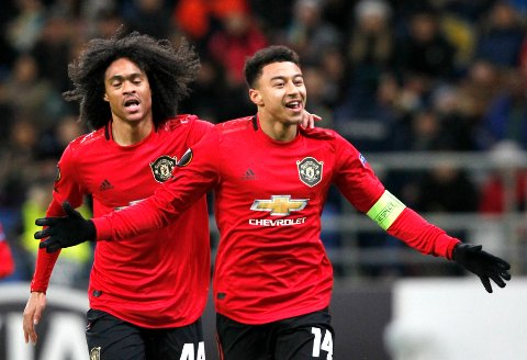 Manchester United's Jesse Lindgard, right, celebrates with teammate Manchester United's Tahith Chong after scoring his side's opening goal during the Europa League Group L soccer match between Astana and Manchester United in Astana, Kazakhstan, Thursday, Nov. 28, 2019. (AP Photo/Stas Filippov)
