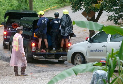 Rescuers move to the entrance to a cave complex where five stil lwere trapped in Mae Sai, Chiang Rai province, northern Thailand Tuesday, July 10, 2018. The eight boys were rescued from the flooded cave. (AP Photo/Sakchai Lalit)