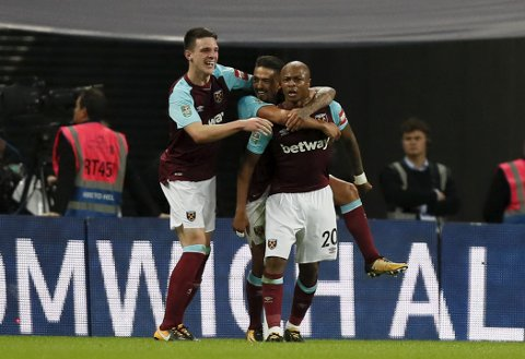 West Ham's Andre Ayew, right, celebrates after he scored his side's second goal during the English League Cup soccer match between Tottenham Hotspur and West Ham at Wembley stadium in London, Wednesday, Oct. 25, 2017. (AP Photo/Kirsty Wigglesworth)
