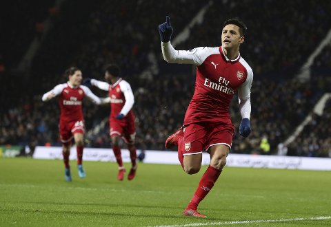 Arsenal's Alexis Sanchez celebrates scoring his side's first goal of the game, during the English Premier League soccer match between West Bromwich Albion and Arsenal, at The Hawthorns, in West Bromwich, England, Sunday, Dec. 31, 2017. (Martin Rickett/PA via AP)