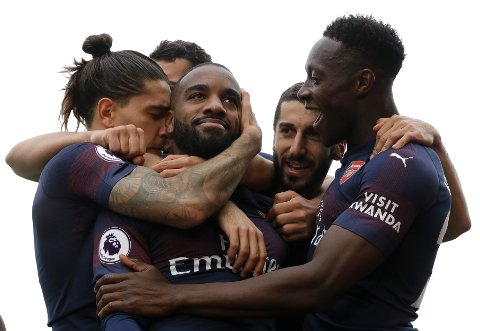 Arsenal's Alexandre Lacazette, centre, celebrates scoring his side's second goal during the English Premier League soccer match between Fulham and Arsenal at Craven Cottage stadium in London, Sunday, Oct. 7, 2018. (AP Photo/Kirsty Wigglesworth)