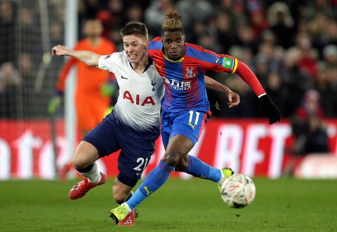 Tottenham's Juan Foyth fights for the ball with Crystal Palace's Wilfried Zaha, right, during an English FA Cup fourth round soccer match between Crystal Palace and Tottenham Hotspur at Selhurst Park in London, Sunday, Jan. 27, 2019. (AP Photo/Tim Ireland)