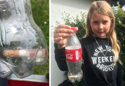 SKUMMELT FUNN: Ingeborg Olavsdatter Berg viser fram giftampullen som de etter hvert sikret i en brusflaske med korken på. Men det var ikke lett for barna å forstå hva de hadde funnet på stranden. Nå vil familien bevisstgjøre andre. Foto:Privat