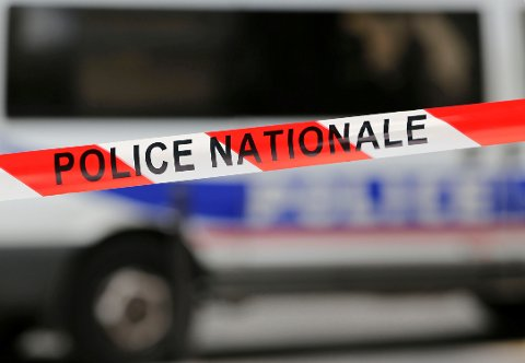 Red and white tape used by the French national police secures a zone from traffic in Paris, France, October 19, 2016. French police officers staged a second night of protests overnight and booed their boss to decry anti-police violence and what they say are insufficient resources to combat criminal gangs as well as the threat of further terrorist attacks.  REUTERS/Regis Duvignau