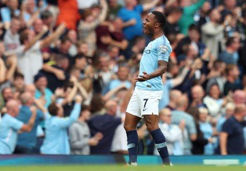 Raheem Sterling jubler etter scoringen sin mot Manchester United. Vi tror han også tegner seg på scoringslisten i tirsdagens kamp. (AP Photo/Jon Super)