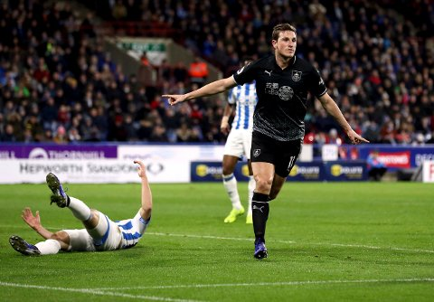 Burnley's Chris Wood celebrates scoring his side's first goal of the game, during the English Premier League soccer match between Huddersfield and Burnley,  at the John Smith's Stadium, in Huddersfield, England, Wednesday, Jan. 2, 2019. (Martin Rickett/PA via AP)