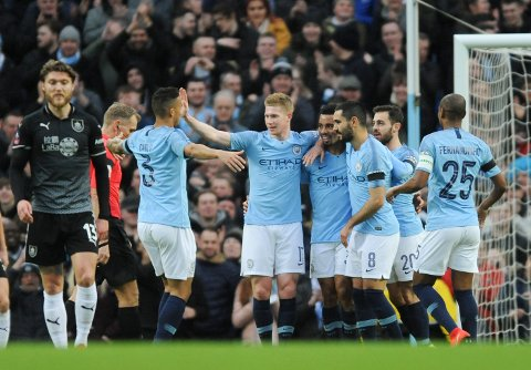 Manchester City's players celebrate after scoring their side's opening goal during the English Premier League soccer match between Manchester City and Burnley at Etihad stadium in Manchester, England, Saturday, Jan. 26, 2019. (AP Photo/Rui Vieira)