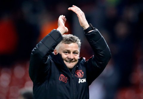Manchester United interim manager Ole Gunnar Solskjaer celebrates defeating Huddersfield after the English Premier League soccer match at Old Trafford.