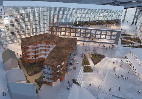 SKALA-OVERGANG: Den u-formede boligblokka blir første byggetrinn på Vervet. Den skal bygges nedenfor de verneverdige og nylig renoverte trehusene i Skansegata (til venstre i bildet). Arkitektene mener blokka vil bli en skala-overgang mellom de små trehusene og den høyere bebyggelsen opp mot Tromsøbrua.