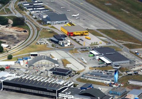Slik vil det se ut når DHL er på plass på terminalområdet. Det er fargene som byggesakseksjonen er skeptiske mot.
