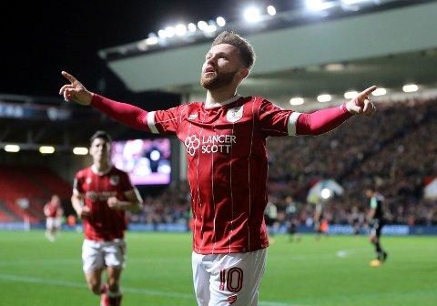 Bristol City's Matty Taylor celebrates scoring his side's first goal of the game against Crystal Palace during their English League Cup, Fourth Round soccer match at Ashton Gate, Bristol, England, Tuesday Oct. 24, 2017.  (Mark Kerton/PA via AP)