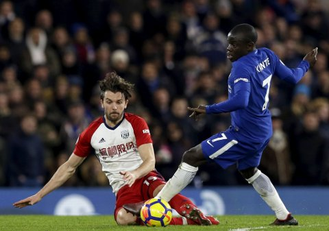 Chelsea's N'Golo Kante, right, vies for the ball with West Bromwich Albion's Jay Rodriguez during the English Premier League soccer match between Chelsea and West Bromwich Albion at Stamford Bridge stadium in London, Monday, Feb. 12, 2018. (AP Photo/Alastair Grant)
