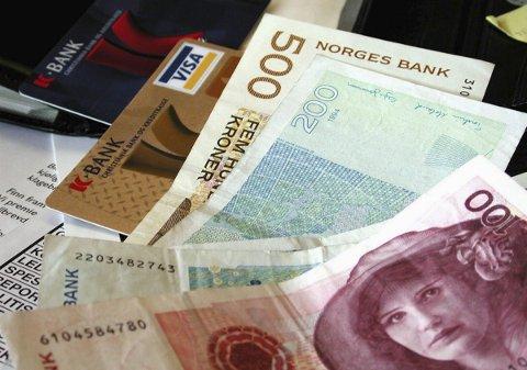 Makt: Det er makt i de foldede sedler. Foto: Hugo Johansen