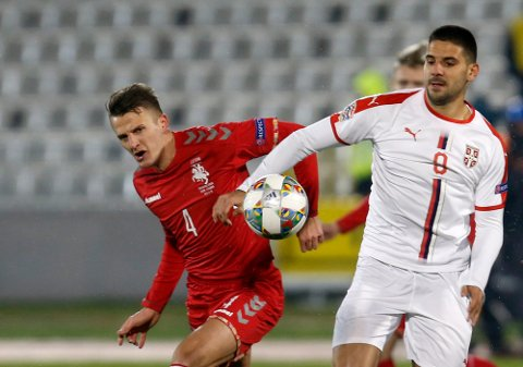 Lithuania's Edvinas Girdvainis, left, duels for the ball with Serbia's Aleksandar Mitrovic during the UEFA Nations League soccer match between Serbia and Lithuania at Partizan stadium in Belgrade, Serbia, Tuesday Nov. 20, 2018. (AP Photo/Darko Vojinovic)