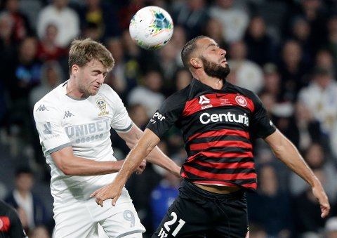 Leeds United's Patrick Bramford, left, and Western Sydney Wanderers' Tarek Elrich compete for a high ball during their friendly soccer match in Sydney, Australia, Saturday, July 20, 2019. (AP Photo/Rick Rycroft)