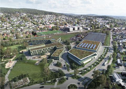 GIGANTISK: Slik ser kommunen for seg den nye skolen (t.v.) og det nye idrettsanlegget med svømmehall på Icopaljordet. Parkanlegg for nærområdet (helt til venstre) og undergang under jernbanen er også inkludert io prosjektet. Illustrasjon: Brick Visual