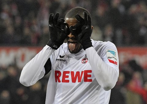 Cologne's Anthony Modeste celebrates after scoring the opening goal during the German Bundesliga soccer match between 1. FC Cologne and Bayer Leverkusen in Cologne, Germany, Wednesday, Dec. 21, 2016. (AP Photo/Martin Meissner)