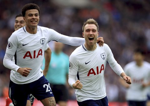 Tottenham Hotspur's Christian Eriksen celebrates scoring his side's first goal of the game with Dele Alli, left, during the Premier League match against Bournemouth at Wembley Stadium, London Saturday Oct. 14, 2017. (John Walton/PA via AP)